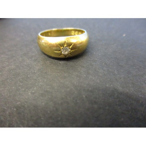 31 - An 18ct gold solitaire diamond ring. Approximate ring size K.