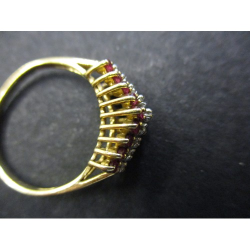 33 - A 585 yellow gold ring set with a central band of diamonds flanked by 2 rows of rubies, approx. ring...