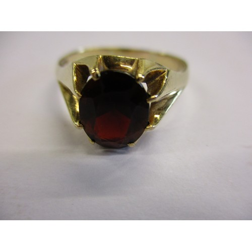35 - A 9ct gold ring, set with a large garnet