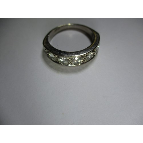 39 - An 18ct white gold ring set with 7 good size diamonds, approx. ring size Q