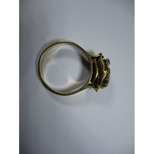 41 - An 18ct yellow gold ring set with 8 diamonds in a stylized setting, approx. ring size P1/2