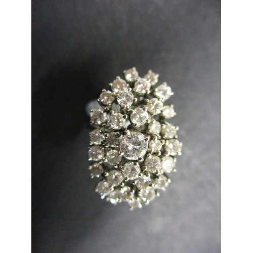 44 - An 18ct white gold and diamond cluster ring. Approximate ring size P.