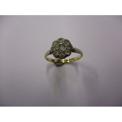 51 - An 18ct yellow gold and platinum diamond daisy cluster ring, approx. ring size J1/2