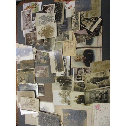 A large quantity of WWI personal photos and postcards, all in pre-owned condition with general age related marks