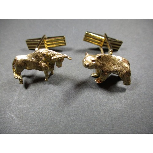 A pair of 14ct gold cufflinks featuring the stock market bull and bear symbols, approx. weight 17g, in good pre-owned usable condition with light use related marks
