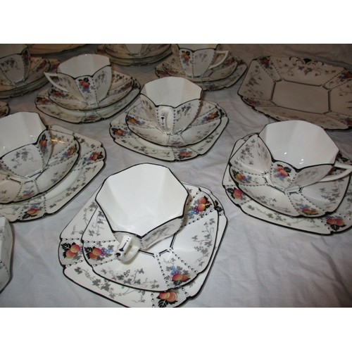 221 - A Shelley 11498 Peaches & Grapes pattern Queen Ann shape tea set, one cup missing from a 12 place se...
