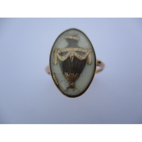 294 - A Georgian gold mourning ring with hair panel in the shape of an urn, dedication reads Rich Rolfe ob...
