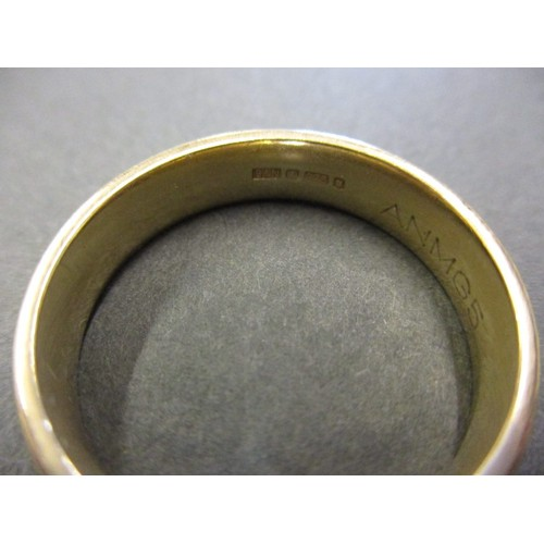 36 - A 9ct yellow gold wedding band, approx. weight 5.9g approx. ring size V in pre-owned condition with ...
