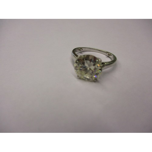 25 - A very large vintage diamond solitaire ring with platinum shank, the stone being approx. 3.12cts. Th...
