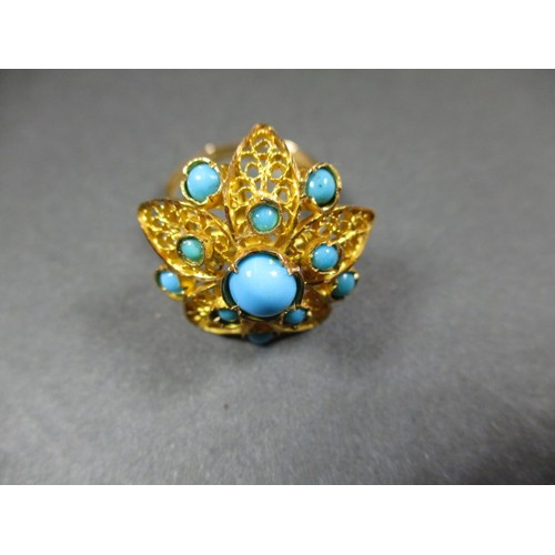 2 - A 750 filigree gold ring, set with beads of turquoise, purchased in Iran in the mid 1980's, approx. ...