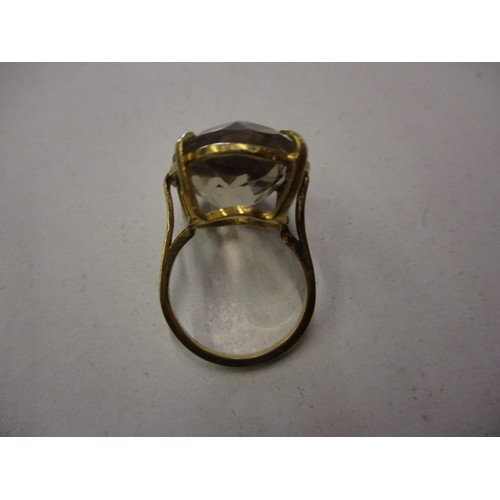 3 - A yellow gold ring set with a large single Smokey Quartz, approx. ring size L In pre-owned condition...