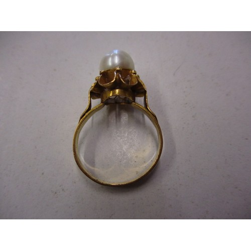 4 - A middle eastern gold ring set with a single pearl, approx. finger size M, approx. weight 3.2g, havi...