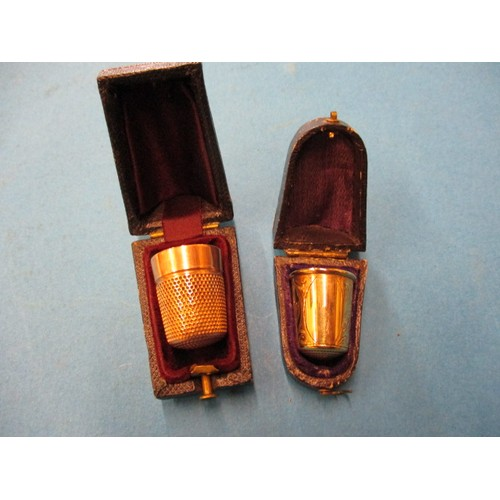 61 - Two vintage 9ct gold sewing thimbles, both in original hard cases, approx. combined weight 11.9g , m...