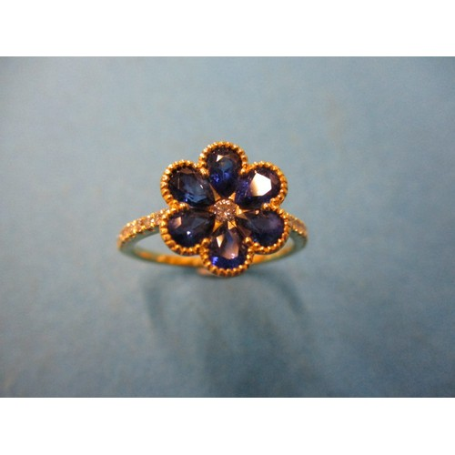 38 - An 18ct yellow gold, diamond and sapphire dress ring, approx. ring size O1/2, in good pre-owned cond...