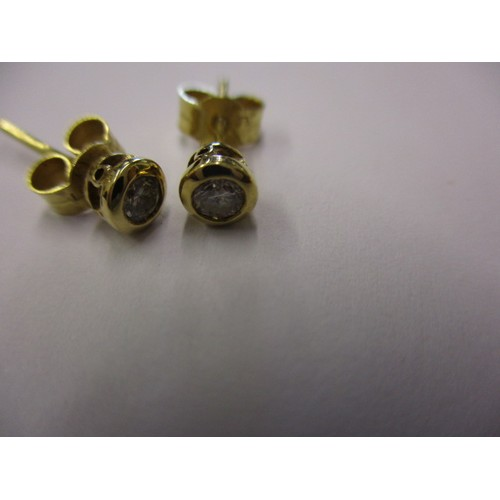 46 - A pair of 9ct yellow gold and diamond stud earrings, in pre-owned condition with minor general age r...