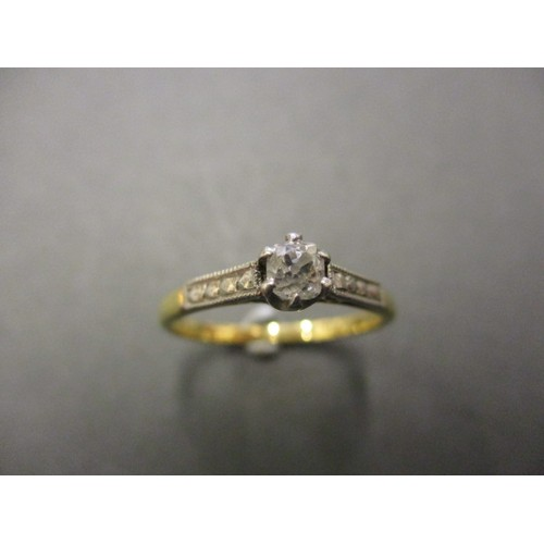 7 - An 18ct yellow gold and platinum diamond solitaire ring, approx. ring size 'N' approx. weight 2.4g i...