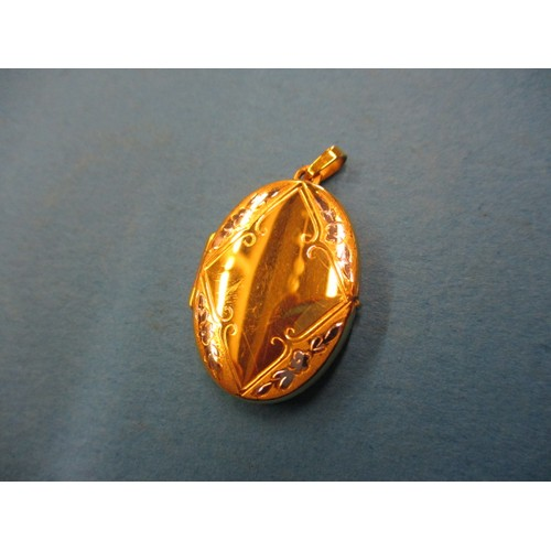 49 - A 9ct yellow and white gold locket pendant, approx. weight 3.8g, in good pre-owned condition