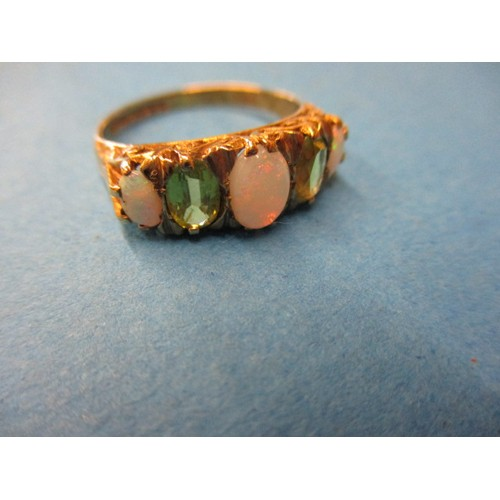 9 - A 9ct yellow gold ring, set with 3 cabochon opals and 2 green stones, approx. ring size 'Q' approx. ...
