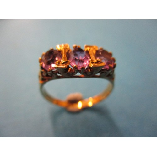 11 - A vintage 9ct yellow gold, 3 stone amethyst ring, approx. ring size 'L' approx. weight 2.4g in good ...