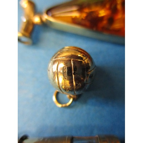 56 - 2, 9ct gold charms, a 9ct gold necklace pendant and a yellow metal pendant, approximate gold weight ...