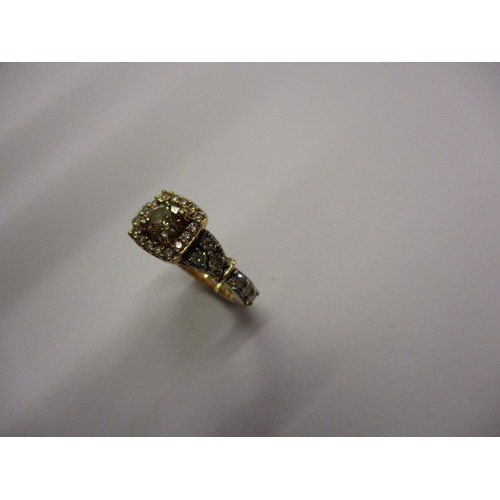 21 - A 14ct gold and diamond cluster ring, with various size diamonds seat to shoulders and square form h...