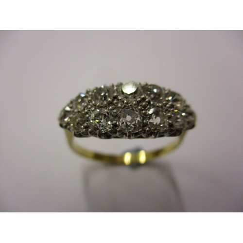 26 - An art deco 18ct gold and platinum diamond cocktail ring set with 12 old cut stones, approx. ring si...