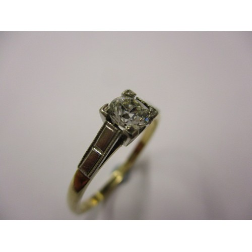 27 - An early 20th century Art Deco gold and platinum, diamond solitaire ring, approx. ring size 'P' appr...