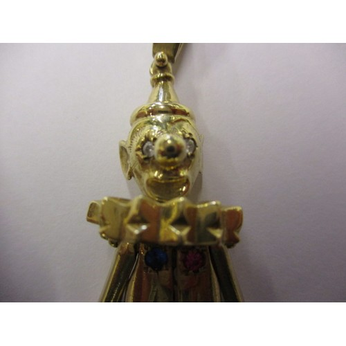 57 - A large 9ct yellow gold Clown pendant, set with various stones and having moving limbs, approx. weig...