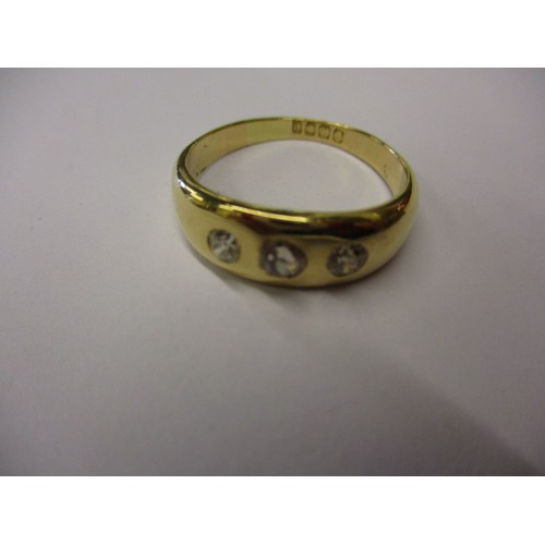 28 - A gents 18ct yellow gold ring set with 3 diamonds, approx. ring size 'V' approx. weight 6.4g in good...