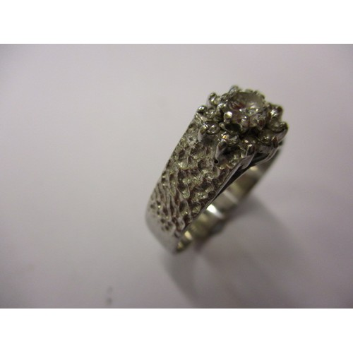 32 - An unmarked platinum and diamond Daisy ring, approx. ring size 'O' approx. weight 5.9g, in good pre ...