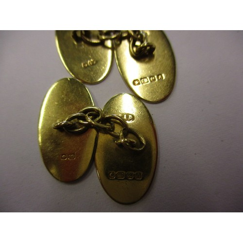 59 - A pair of 18ct yellow gold cufflinks, approx. weight 6.1g, having stylized design to each face, in g...