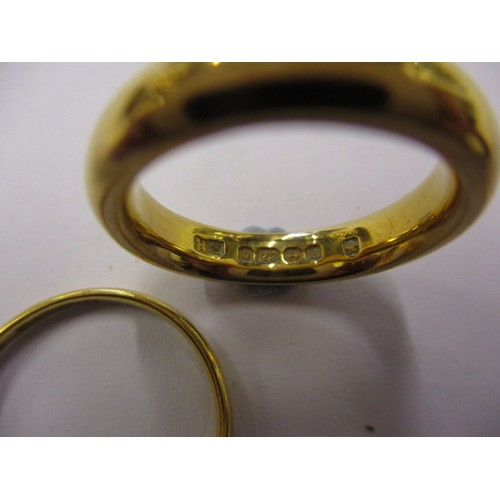 42 - Two 22ct yellow gold wedding bands, approx. weight 10.5g in pre-owned condition with general age rel...