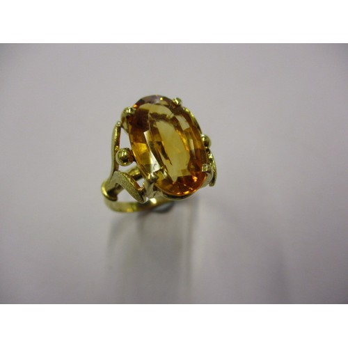 33 - A yellow gold ring marked 750 set with a large Citrine, approx. ring size 'Q' in good pre-owned cond...