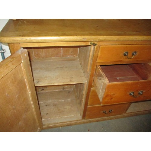 276 - A vintage stripped pine kitchen dresser with upper plate rack. In good useable condition with use-re...