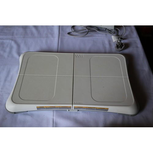 50 - Wii Console with Wires along with Wii Fit Board...