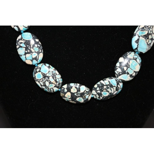 107 - Multi Coloured Marbled Stone Oval Bead Necklace...