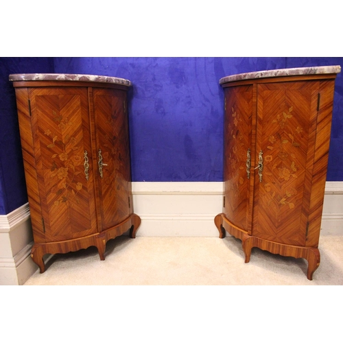 12 - A VERY FINE PAIR OF KINGWOOD MARBLE TOPPED CORNER CABINETS, bow fronted, decorated with fine marquet...