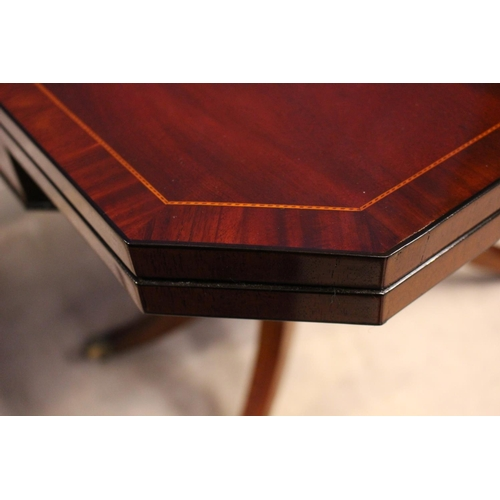 19 - A VERY FINE REGENCY FOLD OVER CARD TABLE, with canted corners raised on 4 turned supports, sitting o...