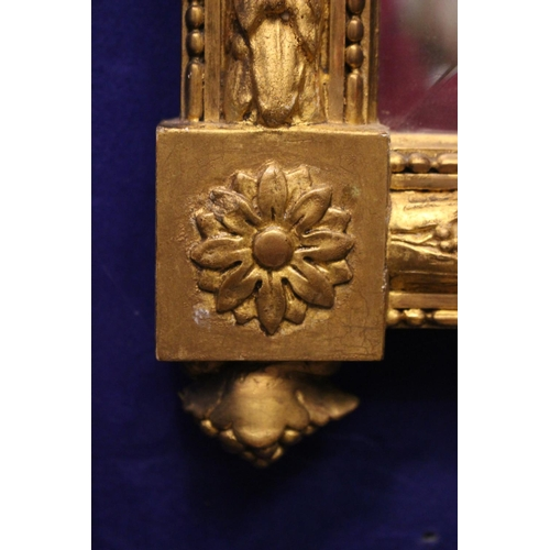 2 - A VERY FINE 19TH CENTURY FRENCH GILT WALL MIRROR, with bevelled glass, decorated with floral and rib...