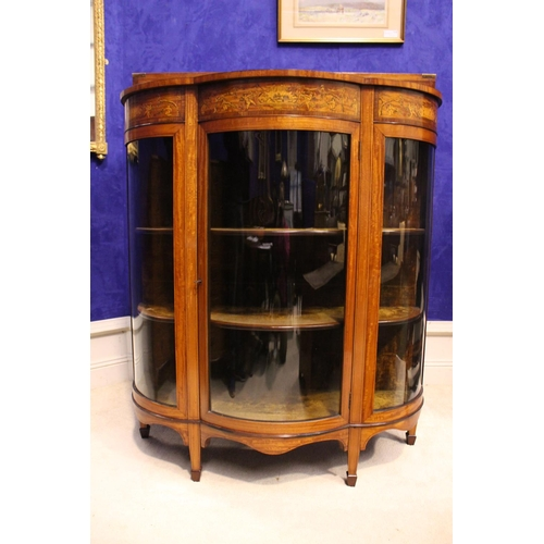 20 - A VERY FINE BOW FRONTED DISPLAY CABINET, decorated to the frieze with inlaid motif of cherubs, eboni...