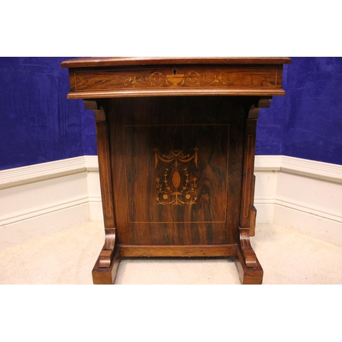 21 - A VERY FINE ROSEWOOD INLAID DAVENPORT, with lift up leather topped writing slope, a raised back with...