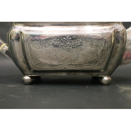 25 - A VERY FINE EARLY 19TH CENTURY IRISH SILVER TEA POT, decorated with bright-cut design all over, cart...
