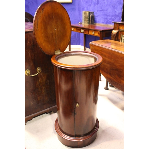 27 - A LATE 19TH CENTURY CYLINDRACAL CABINET, with hinged marble top, a curved single door to the body op...