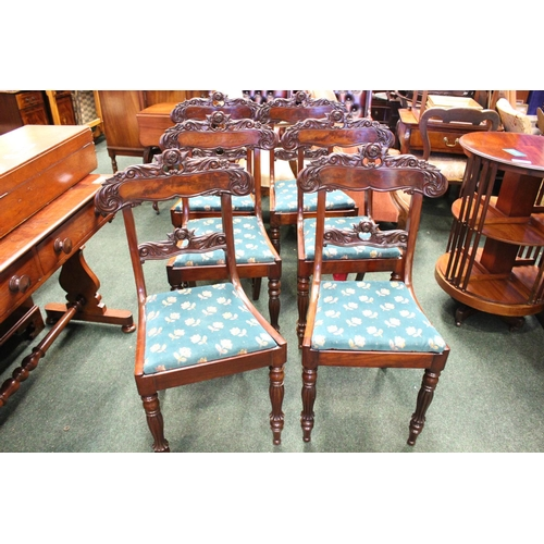 29 - A SET OF 6 MAHOGNAY REGENCY DINING ROOM CHAIRS, with lift up seats, and carved rose motif backs, rai...