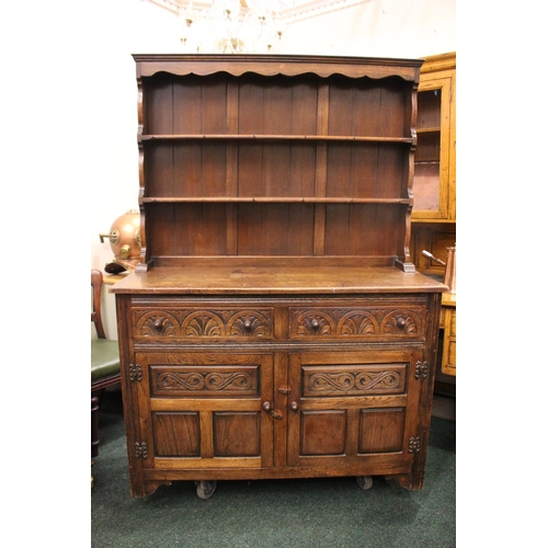 32 - A VERY GOOD 'JAYCEE' OAK DRESSER, with raised gallery shelf to the back, 2 drawers over 2 door cabin...