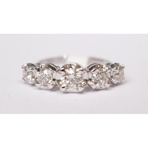 44 - AN 18CT GRADUATED 5 STONE DIAMOND RING,1.14 cts. diamonds...