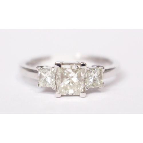 5 - AN 18CT WHITE GOLD PRINCESS CUT 3 STONE DIAMOND RING, diamonds: .44 cts. .95 cts., .44 cts....
