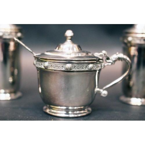 59 - AN IRISH SILVER CONDIMENT SET, includes; (i) Salt Shaker, (ii) Pepper Shaker, (iii) a Mustard pot & ...