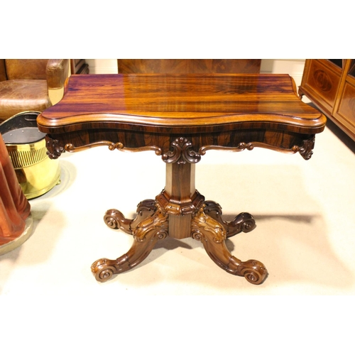 9 - VERY FINE QUALITY 19TH CENTURY ROSEWOOD SERPENTINE SHAPED FOLD-OVER TEA TABLE, raised on an octagona...