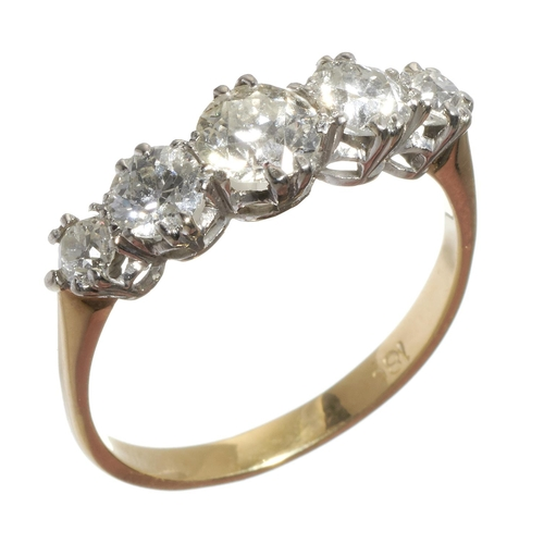 10 - <strong>A DIAMOND FIVE STONE RING</strong>with old cut diamonds, gold hoop marked 18c, 2...